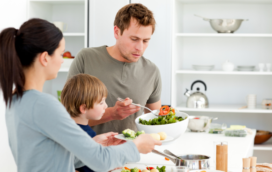 stock-photo-18489734-dad-serving-salad-to-his-family-for-lunch
