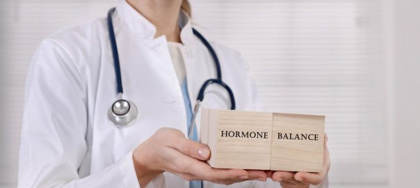 Doctor illustrating balanced hormone health.